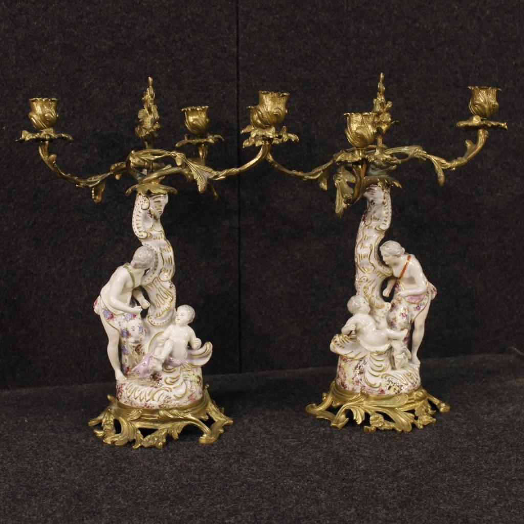 Coppia di candelabri tedeschi in ceramica e bronzo