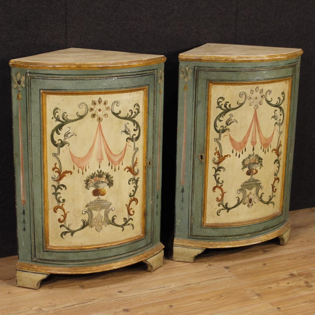 Pair of Italian painted corner cupboards in Louis XVI style