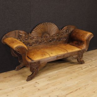 French sofa in carved wood and covered in leather