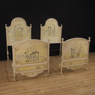 Pair of Italian beds in lacquered and painted iron