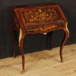French bureau in inlaid wood with golden bronzes