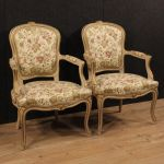 Pair of Italian lacquered and gilded armchairs with floral fabric